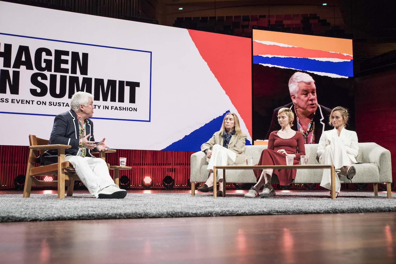 Tim Blanks in a panel discussion at the Copenhagen Fashion Summit with Tonne Goodman, Lily Cole and Amber Valletta on how brands and media houses should go about communicating sustainability